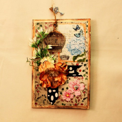 A Wooden caged card